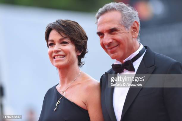 Stefania Rocca and Carlo Capasa walk the red carpet ahead of the Opening Ceremony and the La Vérité screening during the 76th Venice Film Festival at...