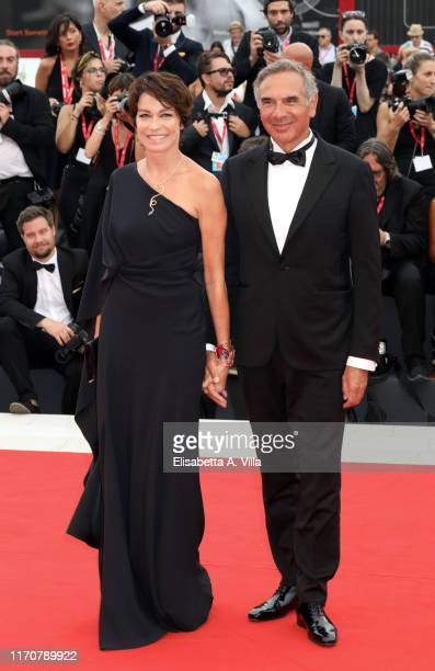 Stefania Rocca and Carlo Capasa walk the red carpet ahead of the opening ceremony during the 76th Venice Film Festival at Sala Casino on August 28...