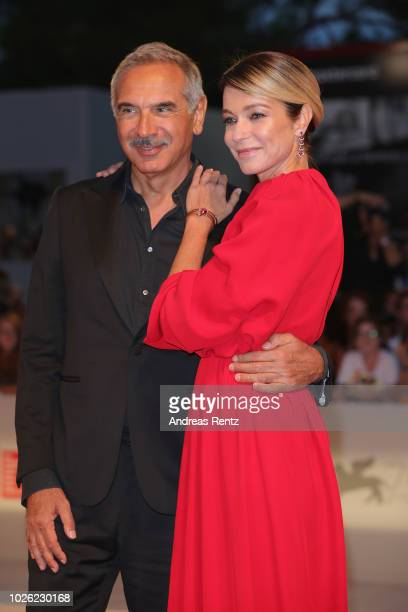 Stefania Rocca and Carlo Capasa walk the red carpet ahead of the 'The Sisters Brothers' screening during the 75th Venice Film Festival at Sala Grande...