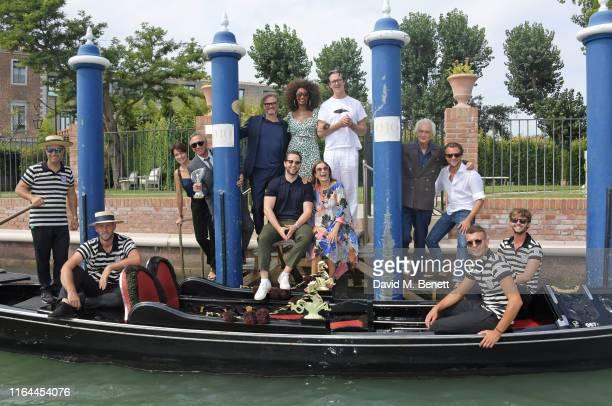 Stefania Rocca Carlo Capasa Colin Firth Derek Blasberg Iman Livia Firth Rupert Everett Fabrizio Servente and Francesco Carrozzini pose with...