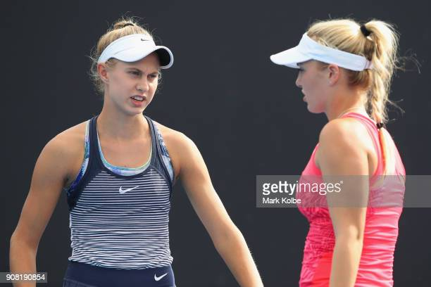 Stefania Rogozinska Dzik of Poland and Ali Collins of Great Britain talk tactics in their doubles match against Gabriella Da Silva Fick of Australia...