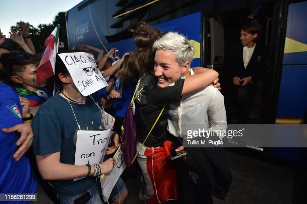 Stefania Tarenzi celebrates with supporters as the team are greeted by celebrating fans upon their arrival at Crown Plaza after winning the 2019 FIFA...