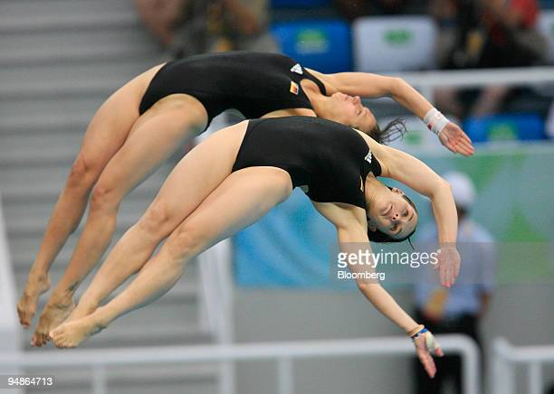 Stefanie Anthes left and Nora Subschinski of Germany perform a flip in the women's 10meter synchronized diving event during day four of the 2008...