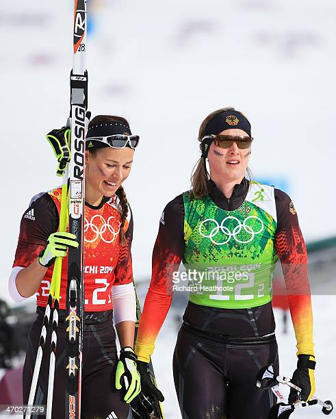 Stefanie Boehler of Germany and Denise Herrmann of Germany react after the Women's Team Sprint Classic Final during day 12 of the 2014 Sochi Winter...