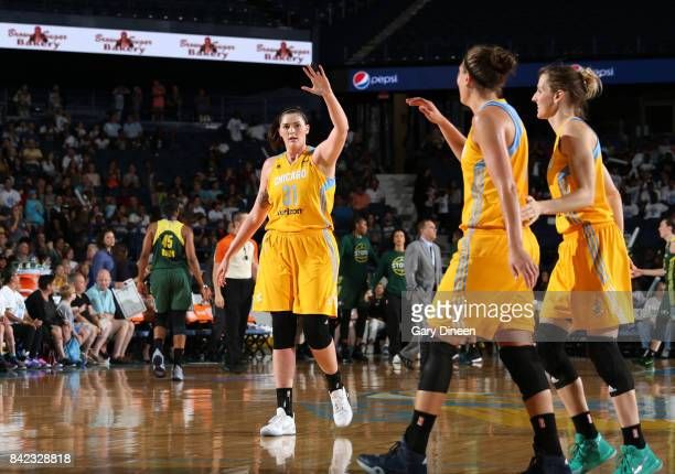 Stefanie Dolson of the Chicago Sky gives high fives to teammates during the game against the Seattle Storm on September 3 2017 at Allstate Arena in...