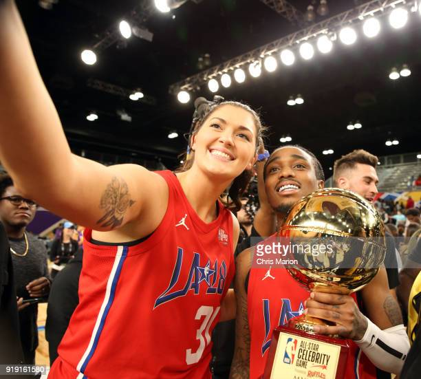 Stefanie Dolson of the Chicago Sky poses with Actor Quavo after he won the MVP trophy during the 2018 NBA AllStar Game Celebrity Game as part of 2018...