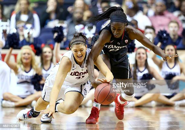 Stefanie Dolson of the Connecticut Huskies and Chiney Ogwumike of the Stanford Cardinal dive for a loose ball in the first half during the NCAA...