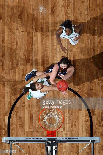 Stefanie Dolson of the Connecticut Huskies attempts a shot against Natalie Achonwa of the Notre Dame Fighting Irish during the National Semifinal...