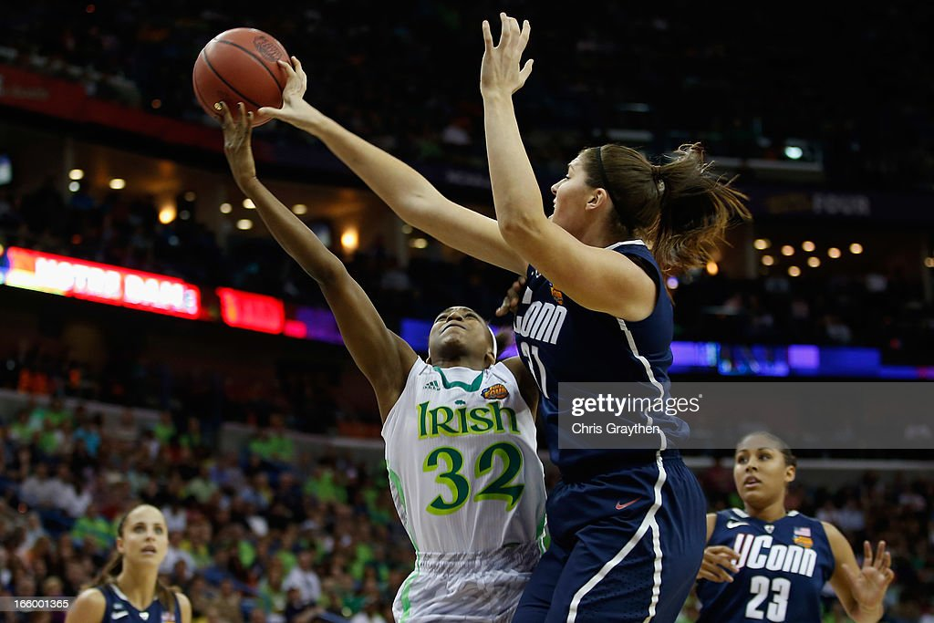 Stefanie Dolson #31 of the Connecticut Huskies blocks a shot by Jewell Loyd #32 of the Notre Dame Fighting Irish during the National Semifinal game of the 2013 NCAA Division I Women's Basketball Championship at the New Orleans Arena on April 7, 2013 in New Orleans, Louisiana.