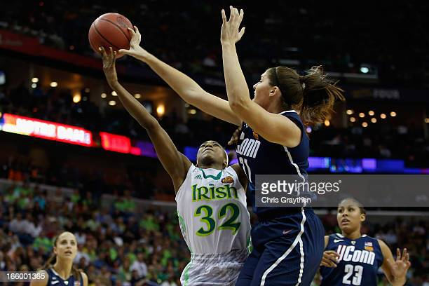 Stefanie Dolson of the Connecticut Huskies blocks a shot by Jewell Loyd of the Notre Dame Fighting Irish during the National Semifinal game of the...