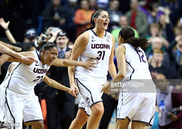 Stefanie Dolson of the Connecticut Huskies celebrates with her teammate Kaleena Mosqueda-Lewis and Saniya Chong after defeating the Notre Dame...