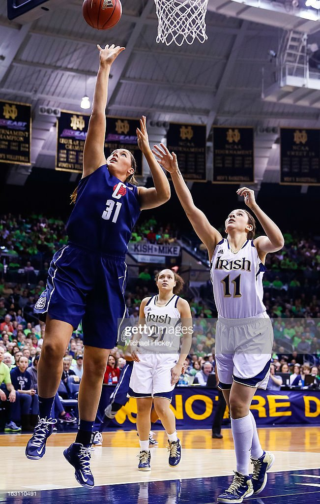 Stefanie Dolson #31 of the Connecticut Huskies shoots the ball against Natalie Achonwa #11 of the Notre Dame Fighting Irish at Purcel Pavilion on March 4, 2013 in South Bend, Indiana. Notre Dame defeated Connecticut 96-87 in triple overtime to win the Big East regular season title.