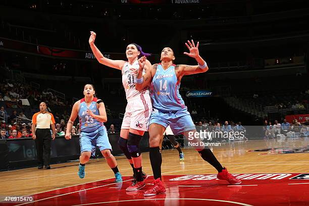 Stefanie Dolson of the Washington Mystics and Erika de Souza of the Atlanta Dream look on for a rebound in a WNBA game at the Verizon Center on June...