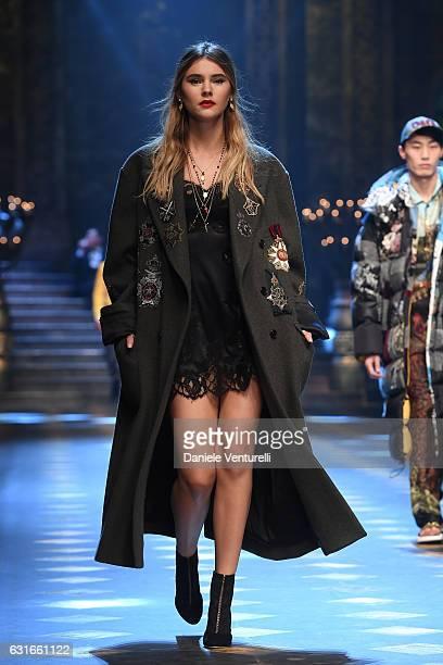 Stefanie Giesinger walks the runway at the Dolce Gabbana show during Milan Men's Fashion Week Fall/Winter 2017/18 on January 14 2017 in Milan Italy