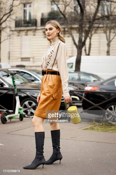 Stefanie Giesinger wearing Miu Miu beige shirt mustard Bermuda shorts black sockboots yellow drum bag outside the Miu Miu show during Paris Fashion...