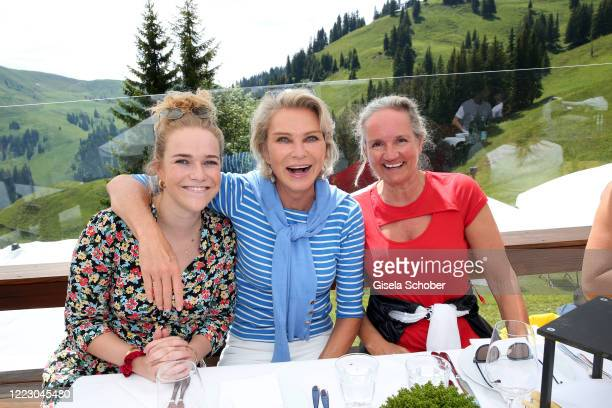 Stefanie Graefin von Pfuel and her daughter Amelie Bagusat and Uli Ehrlich Dirndl fashion designer and owner Sportalm during the first Ladies Day and...