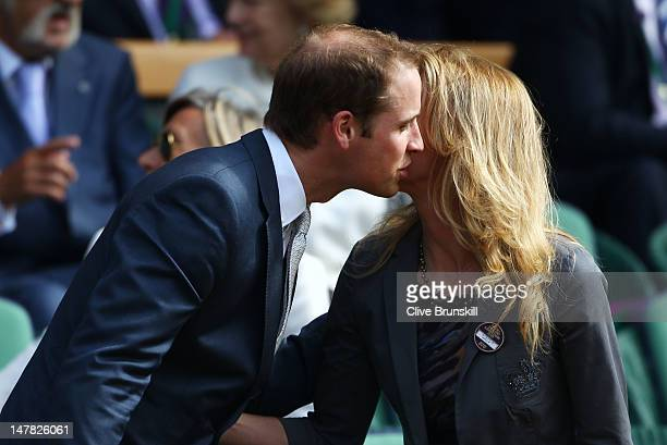 Stefanie Graf greets Prince William Duke of Cambridge in the Royal Box on Centre Court during day nine of the Wimbledon Lawn Tennis Championships at...