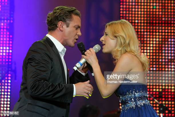 Stefanie Hertel and Stefan Mross performs at the benefit concert Stefanie Hertel Stefan Mross Freunde Live at the Europapark on August 26 2011 in...