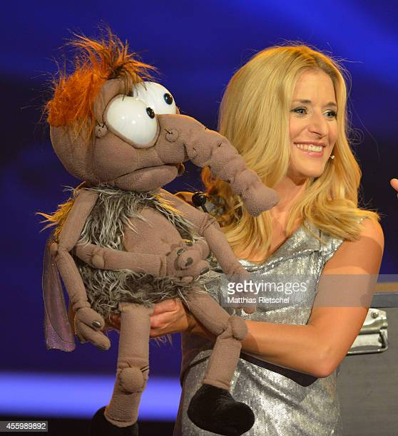 Stefanie Hertel carries a puppet as she performs during the rehearsal of the tv show 'Stefanie Hertel Meine Stars' on September 23 2014 in Zwickau...
