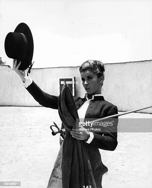 Stefanie Powers holding up hat in a scene from the film 'Love Has Many Faces' 1965