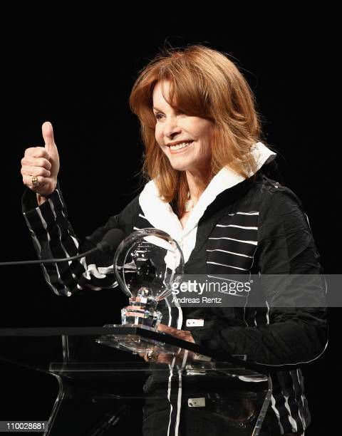 Stefanie Powers holds her award during the Steiger Award 2011 at the Jahrhunderthalle on March 12 2011 in Bochum Germany