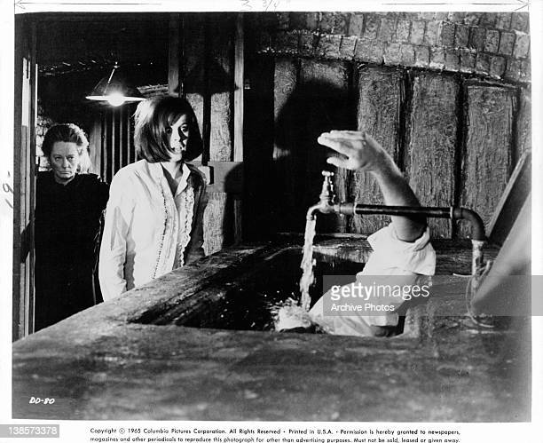 Stefanie Powers is force by Tallulah Bankhead to look at the dead body in the tub of running water in a scene from the film 'Die Die My Darling' 1965