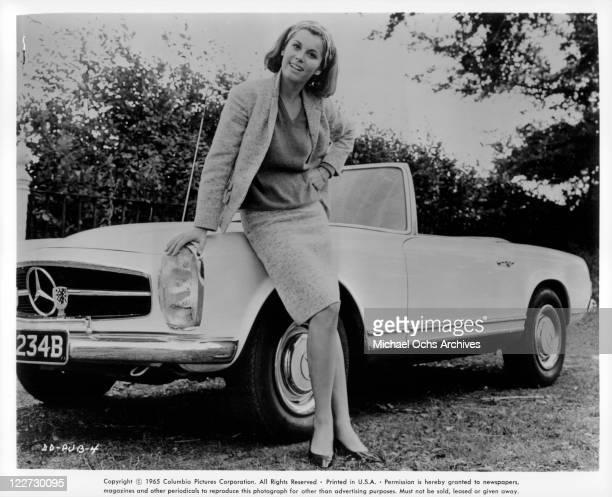 Stefanie Powers leaning up against convertable Mercedes Benz in a scene from the film 'Die Die My Darling' 1965