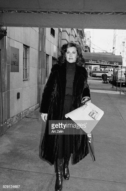Stefanie Powers wearing a mink coat walking on the street circa 1970 New York