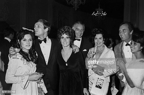 Stefanie Powers with friends wearing a velvet evening dress circa 1970 New York