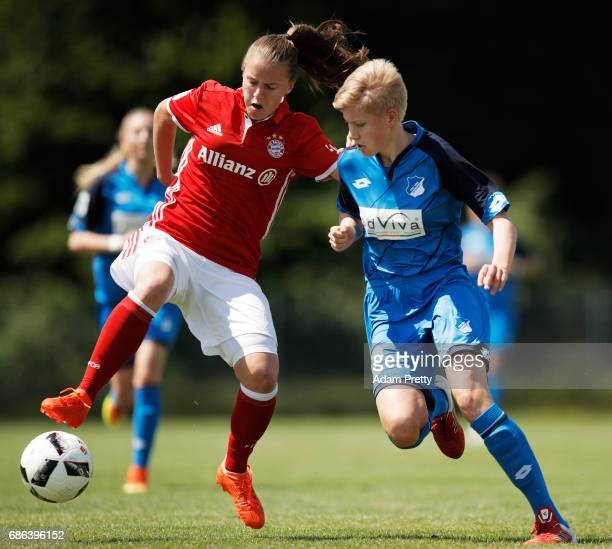 Stefanie Reischmann of FC Bayern Munich II is challenged by Paulina Krumbiegel of Hoffenheim II during the match between 1899 Hoffenheim II and FCB...