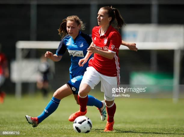 Stefanie Reischmann of FC Bayern Munich II is challenged by Sarai Linder of Hoffenheim II during the match between 1899 Hoffenheim II and FCB...