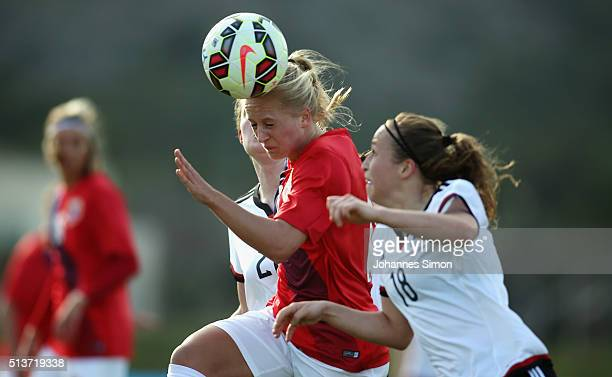 Stefanie Sanders and Michaela Specht of Germany and Amalie Vevle Eikeland of Norway fight for the ball during the women's U23 international friendly...