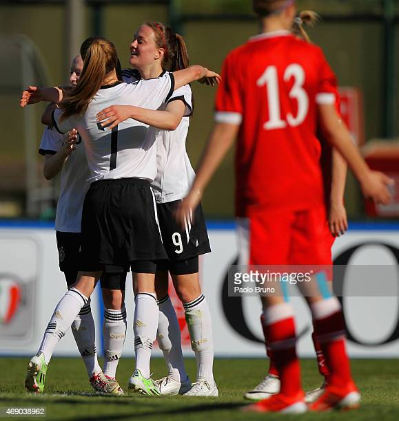 Stefanie Sanders with her teammates of Germany celebrates afters scoring the team's fourth goal during the UEFA Under17 women's Elite Round match...
