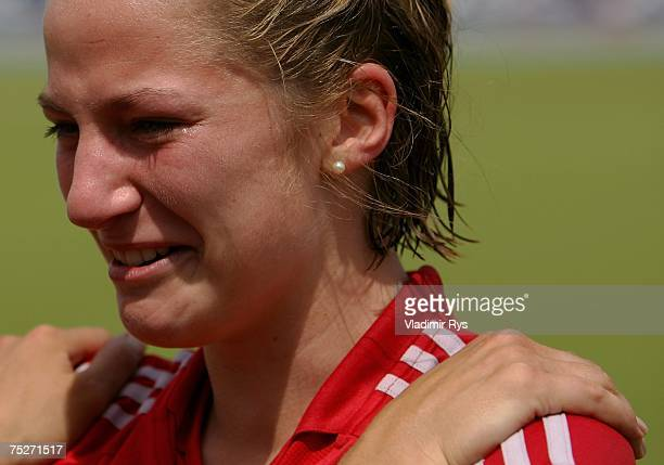 Stefanie Schneider of RW Koeln cries during celebrations of her team after winning 21 the womens final of the German Field Hockey Championship...