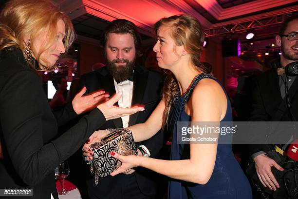 Stefanie Sick Antoine Monot Jr and Nina Eichinger part the jewellery from the clutch during the German Film Ball 2016 party at Hotel Bayerischer Hof...