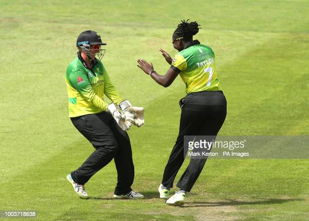 Stefanie Taylor of Western Storm celebrates running out Beth Mooney of Yorkshire Storm with wicket keeper Rachel Priest during the Kia Super League...