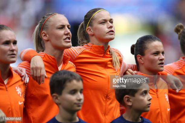 Stefanie Van der Gragt and Amouk Dekker of the Netherlands sing the national anthem prior to the 2019 FIFA Women's World Cup France Final match...