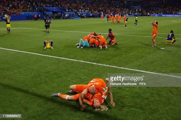 Stefanie Van der Gragt and Shanice Van De Sanden of the Netherlands celebrate following their sides victory in the 2019 FIFA Women's World Cup France...