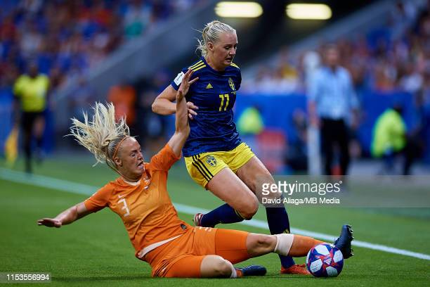 Stefanie Van Der Gragt of Netherlands and Sina Blackstenius of Sweden competes for the ball during the 2019 FIFA Women's World Cup France Semi Final...