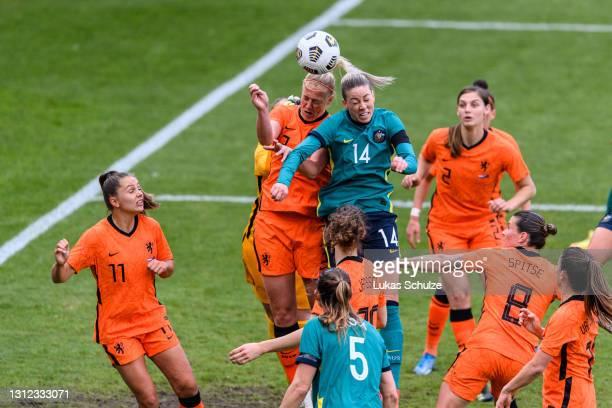 Stefanie van der Gragt of Netherlands challenges for the ball with Alanna Kennedy of Australia during the International Friendly between Netherlands...