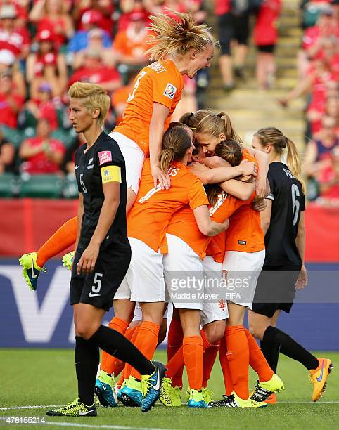 Stefanie Van Der Gragt of Netherlands jumps on top of Lieke Martens after she scored a goal against the New Zealand during the FIFA Women's World Cup...