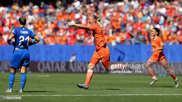 Stefanie Van der Gragt of the Netherlands celebrates after scoring her team's second goal as Valentina Cernoia of Italy reacts during the 2019 FIFA...