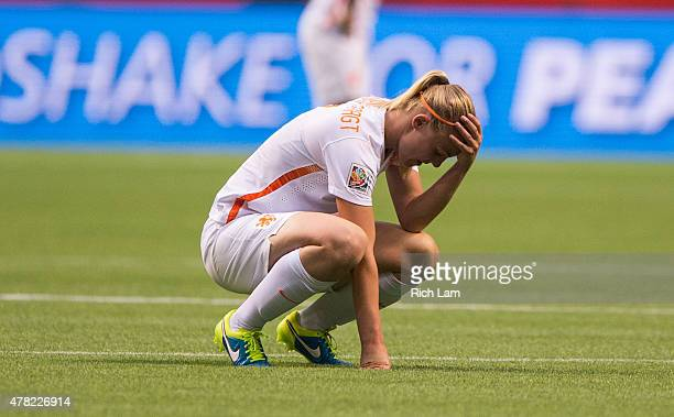 Stefanie van der Gragt of the Netherlands sits dejectedly after losing to Japan 2-1 during the FIFA Women's World Cup Canada 2015 Round of 16 match...