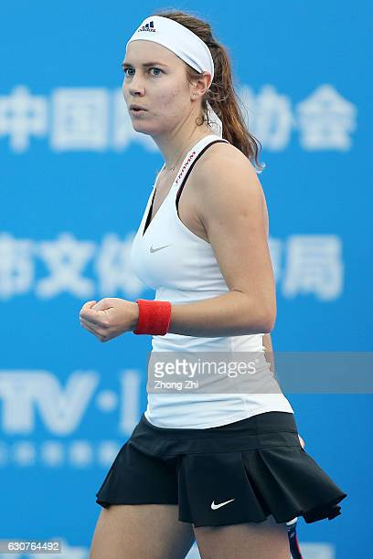 Stefanie Voegele of Switzerland celebrates a shot during her qualifying match against Veronika Kudermetova of Russia during 2017 WTA Shenzhen Open at...