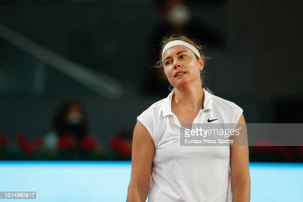 Stefanie Voegele of Switzerland laments during her Women's Singles Qualifying match against Irina-Camelia Begu of Romania during the WTA 1000 - Mutua...