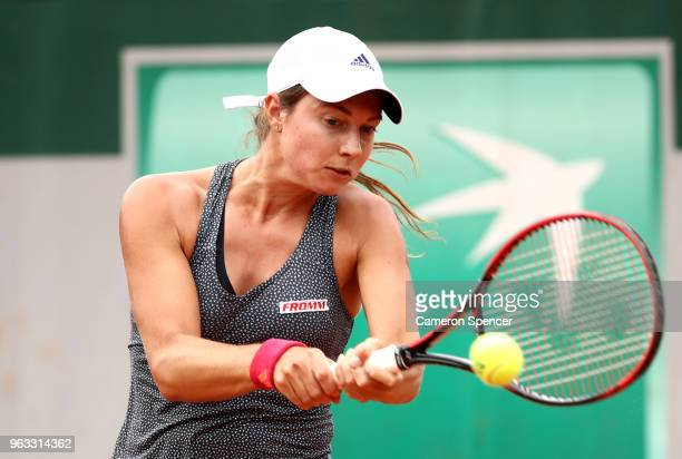 Stefanie Voegele of Switzerland plays a backhand during the ladies singles first round match against Lesia Tsurenko of Ukraine during day two of the...