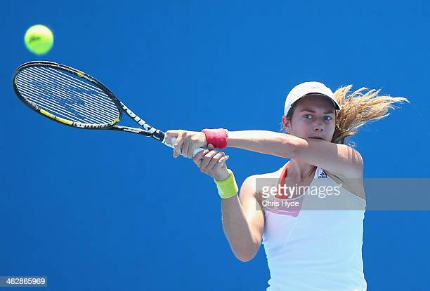 Stefanie Voegele of Switzerland plays a backhand in her second round match against Dominika Cibulkova of Slovakia during day four of the 2014...