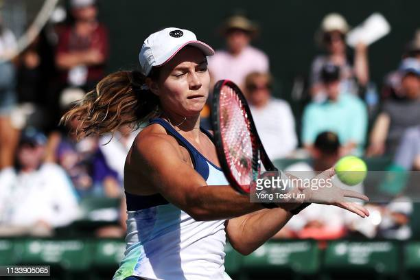 Stefanie Voegele of Switzerland plays a forehand against Sara Errani of Italy during their second round qualifying match on Day 2 of the BNP Paribas...