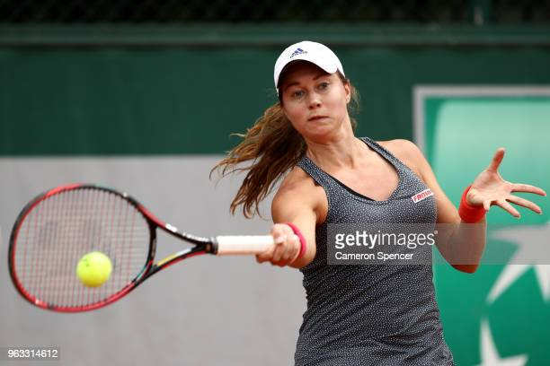 Stefanie Voegele of Switzerland plays a forehand during the ladies singles first round match against Lesia Tsurenko of Ukraine during day two of the...