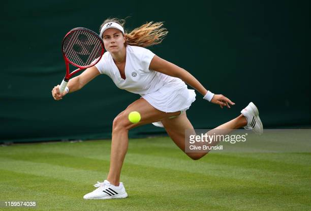 Stefanie Voegele of Switzerland plays a forehand in her Ladies' Singles first round match against Kaia Kanepi of Estonia during Day two of The...